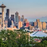 Seattle skyline panorama seen from Kerry Park at sunset in golden evening light with Mount Rainier in the background, Washington State