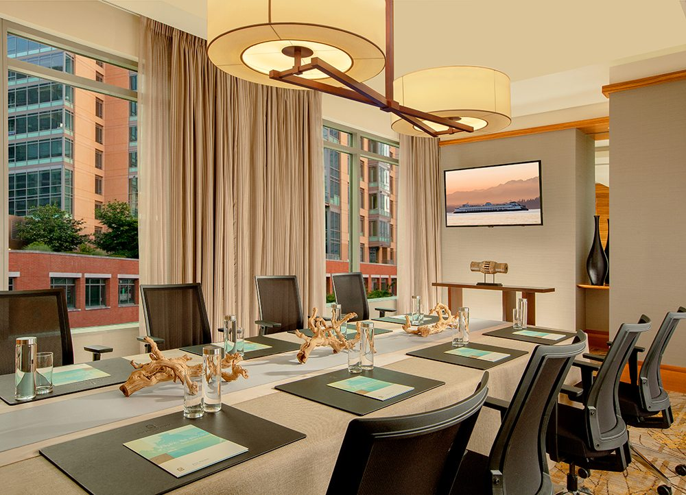 Conference room in Seattle that overlooks the plaza, with large table, ergonomic chairs, and audiovisual equipment