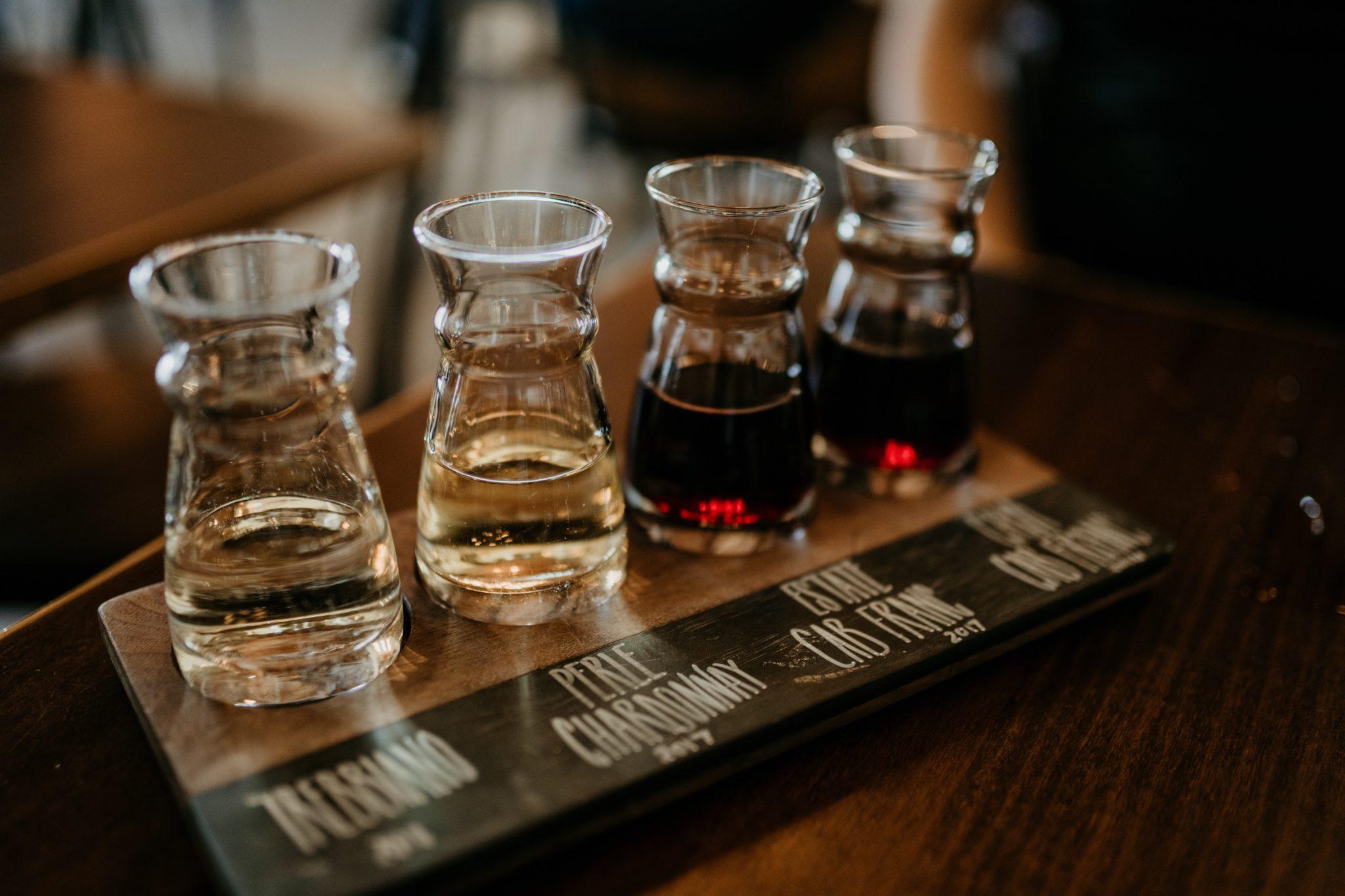 four wine sampler glasses